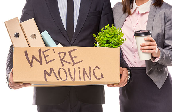 Office employees getting ready to move to new office